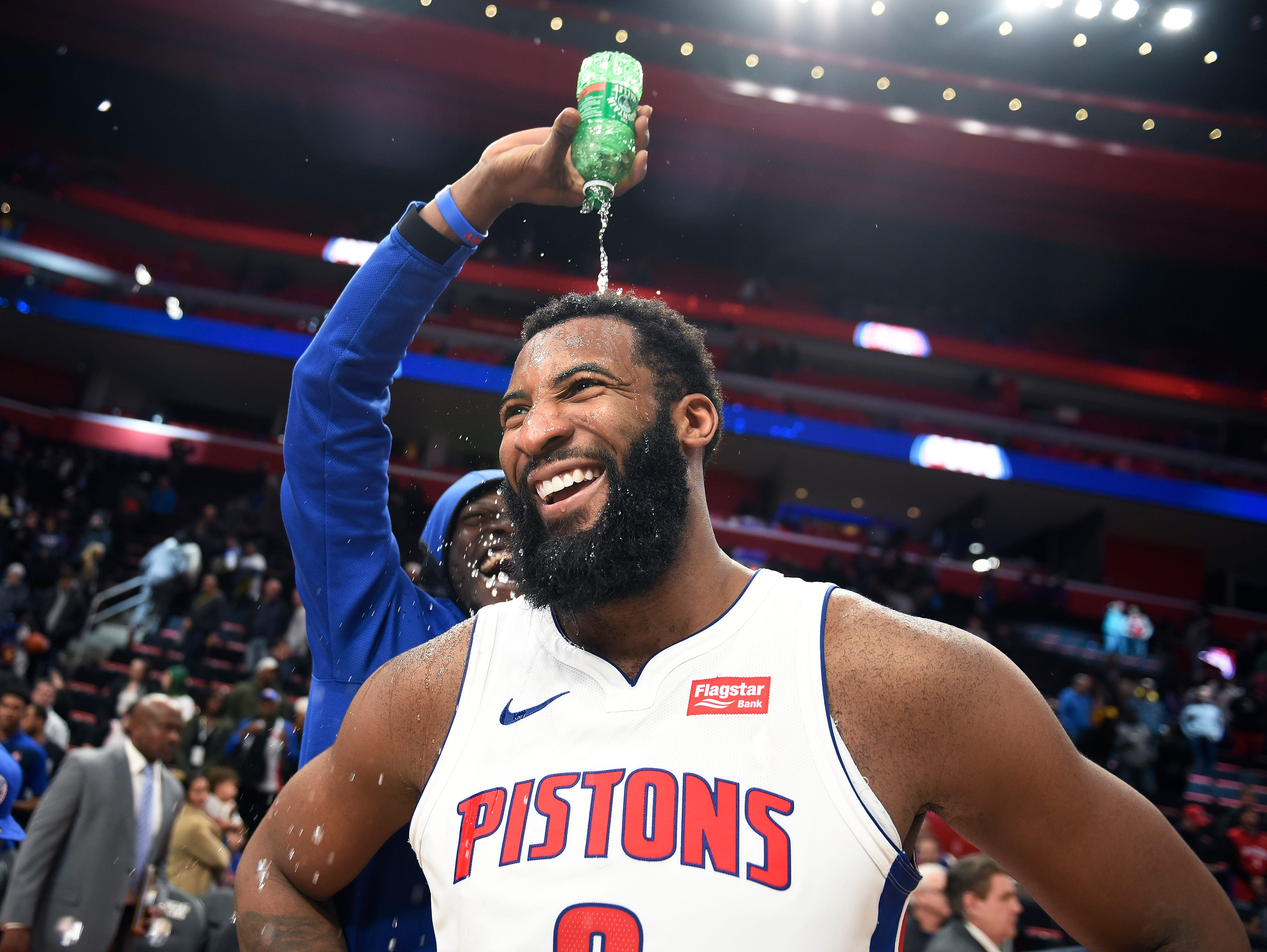 Pistons' Andre Drummond receives a shower from Reggie Jackson during his postgame interview.