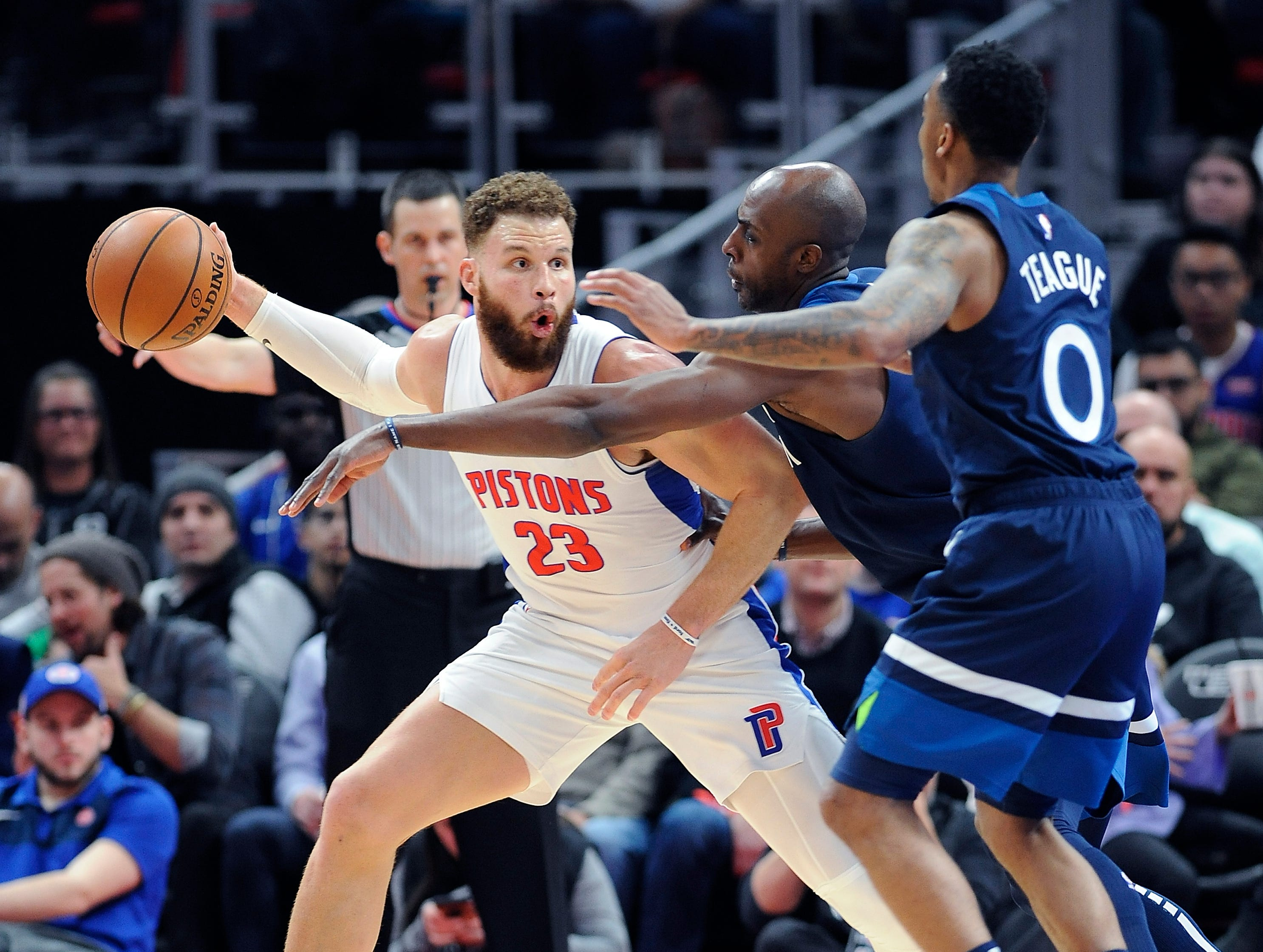 Pistons' Blake Griffin looks for room around Timberwolves' l-r, Anthony Tolliver and Jeff Teague in the fourth quarter.