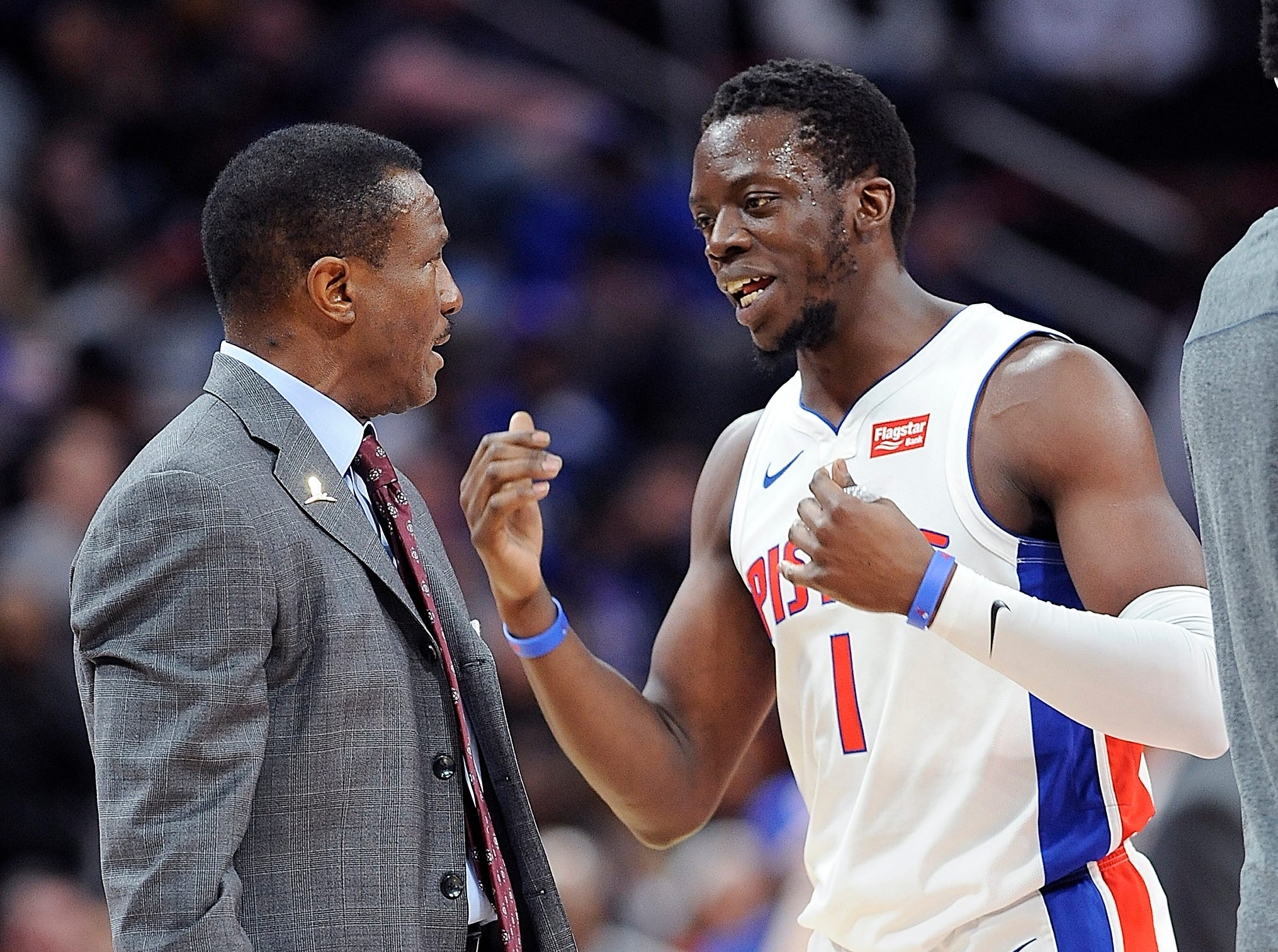 Pistons' Reggie Jackson talks to head coach Dwane Casey during a timeout in the second quarter.