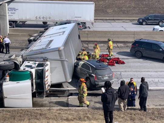 An overturned semi truck crushes a passenger vehicle on Interstate 94 at the 10 Mile overpass in Roseville.