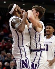 Northwestern center Dererk Pardon, left, celebrates with forward Miller Kopp after scoring a basket against Ohio State during the second half.