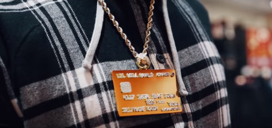 Jonathan Woods stars in YouTube rap videos wearing a jewel-encrusted credit card necklace.