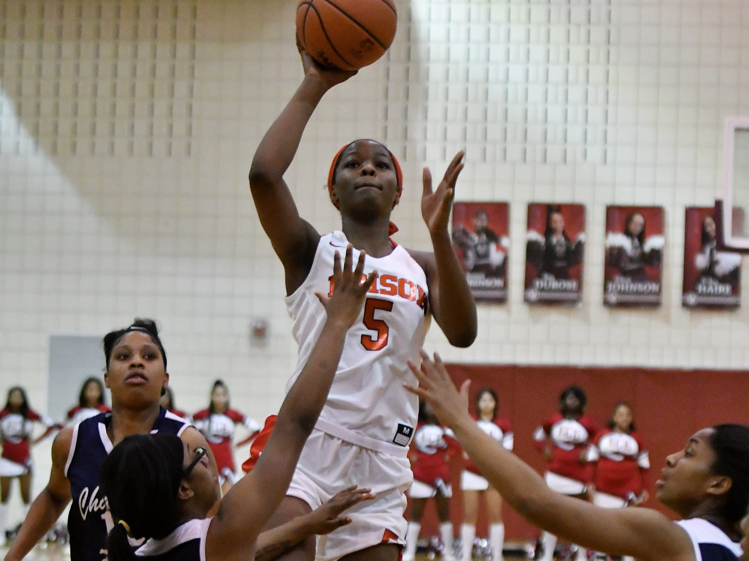 Detroit Edison's Rickea Jackson (5) shoots over Chandler Park's Anaya Kennedy, left, and Taylor Walton in the first half.
