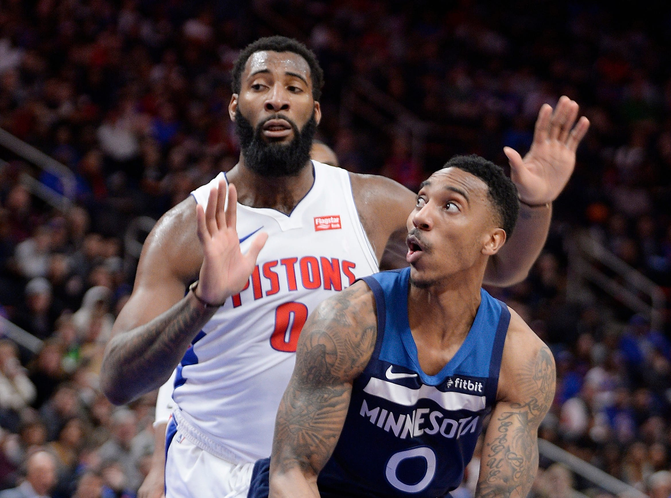 Timberwolves' Jeff Teague looks for room around Pistons' Andre Drummond in the third quarter.