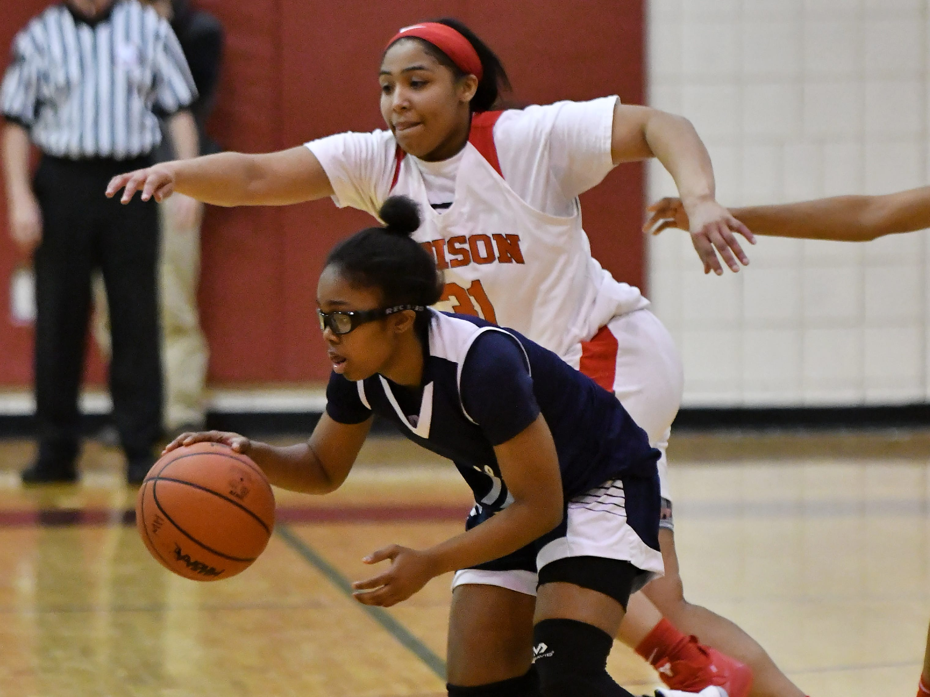 Detroit Edison's Keairra Jennings (31) chases Chandler Park's Emaia O'Brien, front, in the first half.