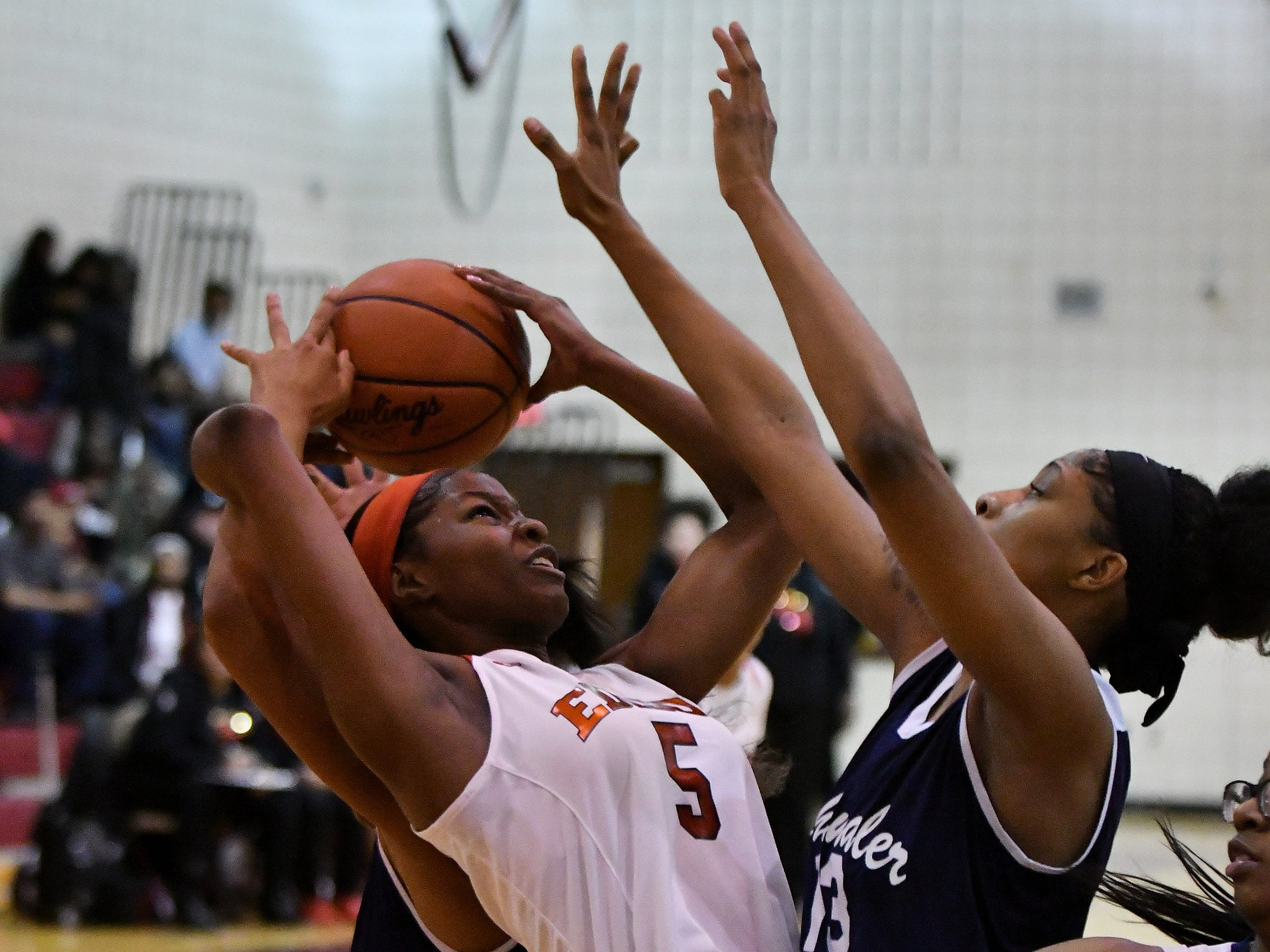 Detroit Edison's Rickea Jackson (5) battles for the ball with Chandler Park's Kaylyn Pendleton, right, and Taylor Walton, left, in the first half.
