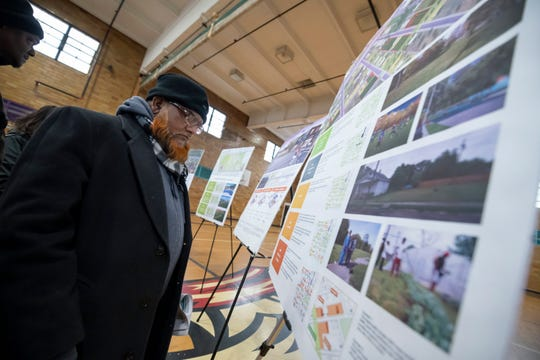 Mohamad Rahman looks over renderings at a meeting at Frontier Academy in Detroit on March 6, 2019. The meeting showcased recommendations for the Campau/Davison/Banglatown neighborhood through the city of Detroit's Strategic Neighborhood Fund.
