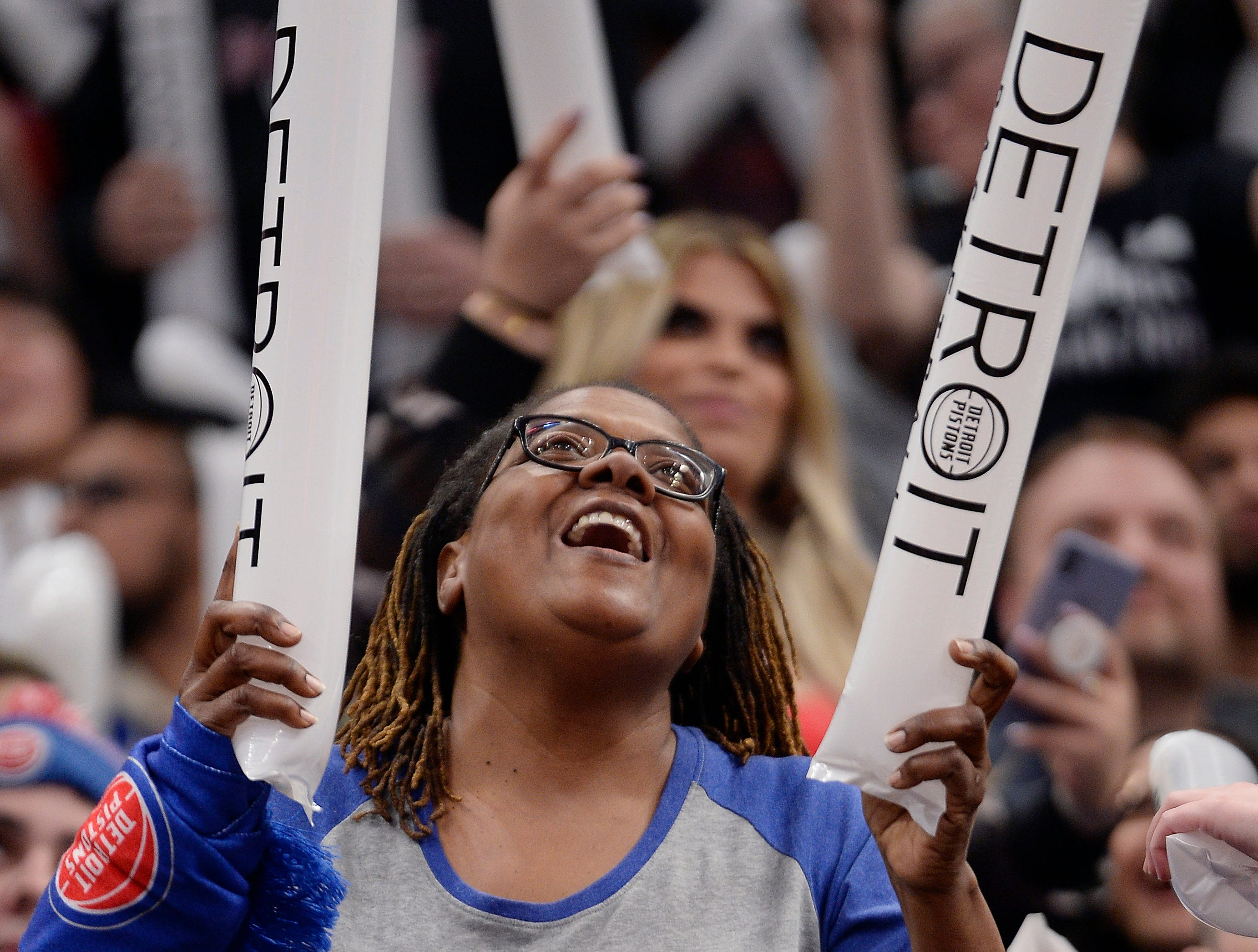 Vivian Simpson, 60, of Detroit cheers during the fourth quarter.