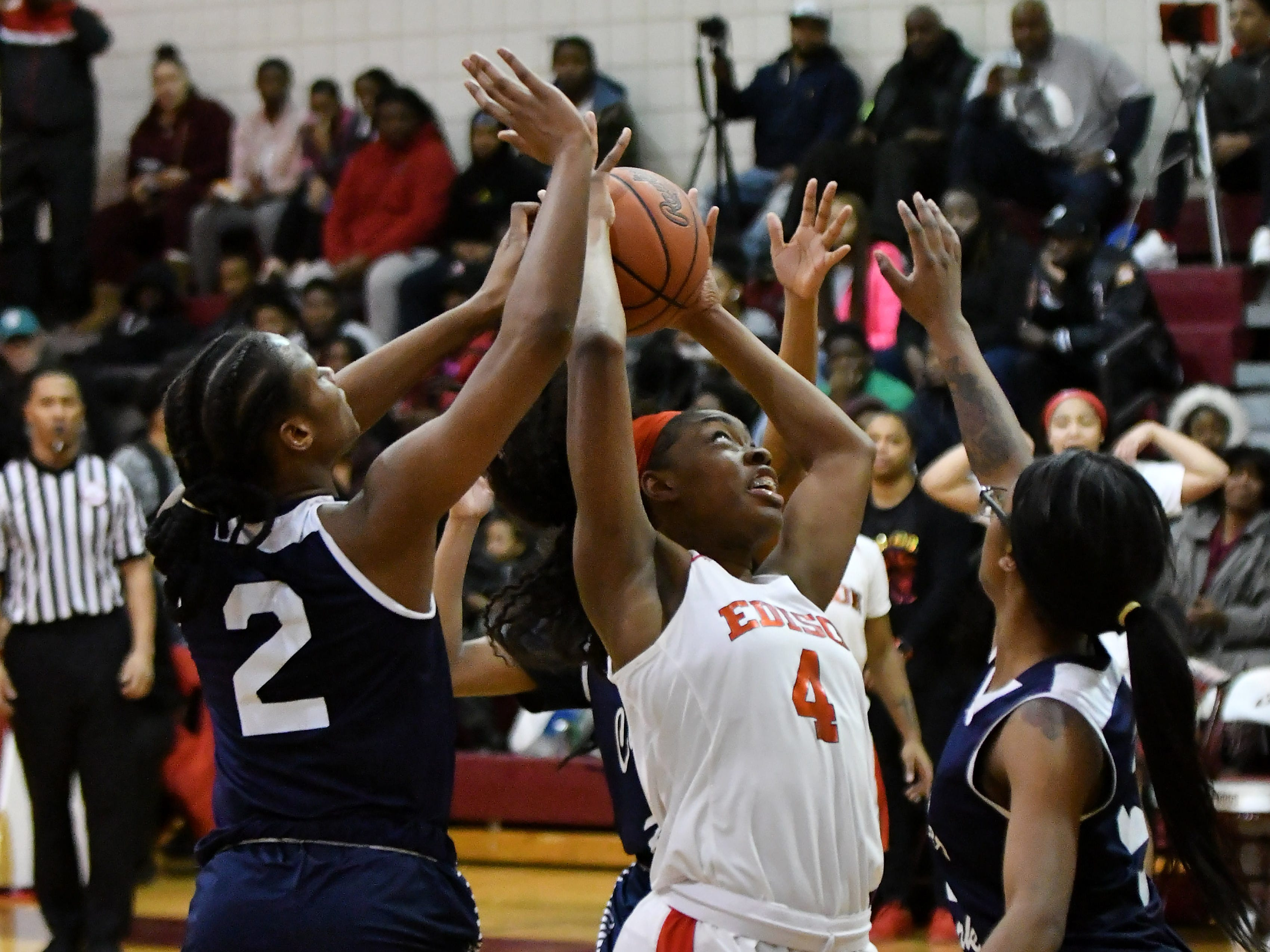 Detroit Edison's Ariel Jenkins tries to hold onto the ball amidst Chandler Park's Tiana Mason (2) and Anaya Kennedy, right, in the second half.
