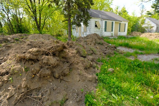 Fresh piled dirt is seen near a vacant home on Faust near Constance in Detroit after a demolition on May 18, 2016.