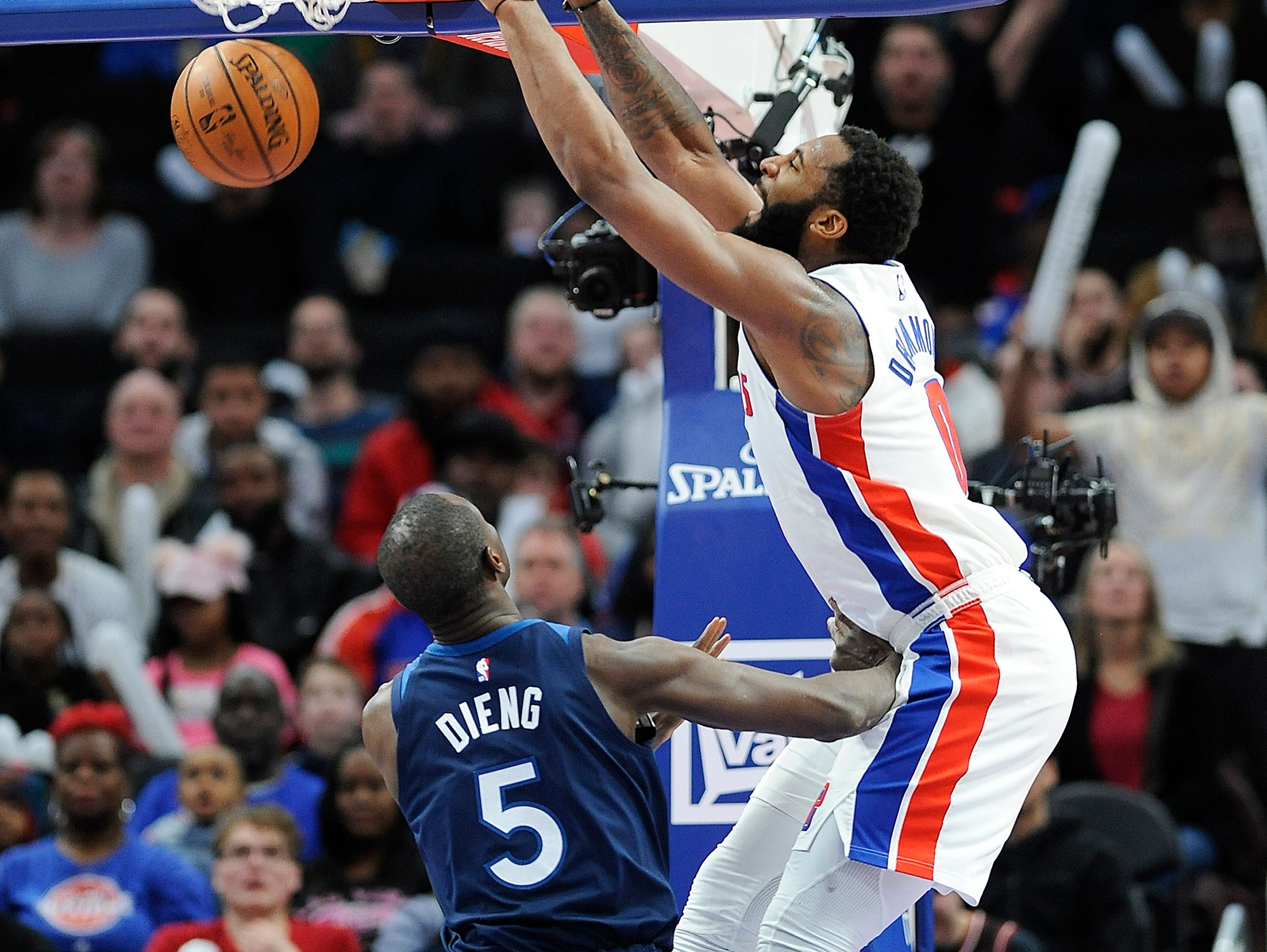 Pistons' Andre Drummond dunks over Timberwolves' Gorgui Dieng in the fourth quarter.