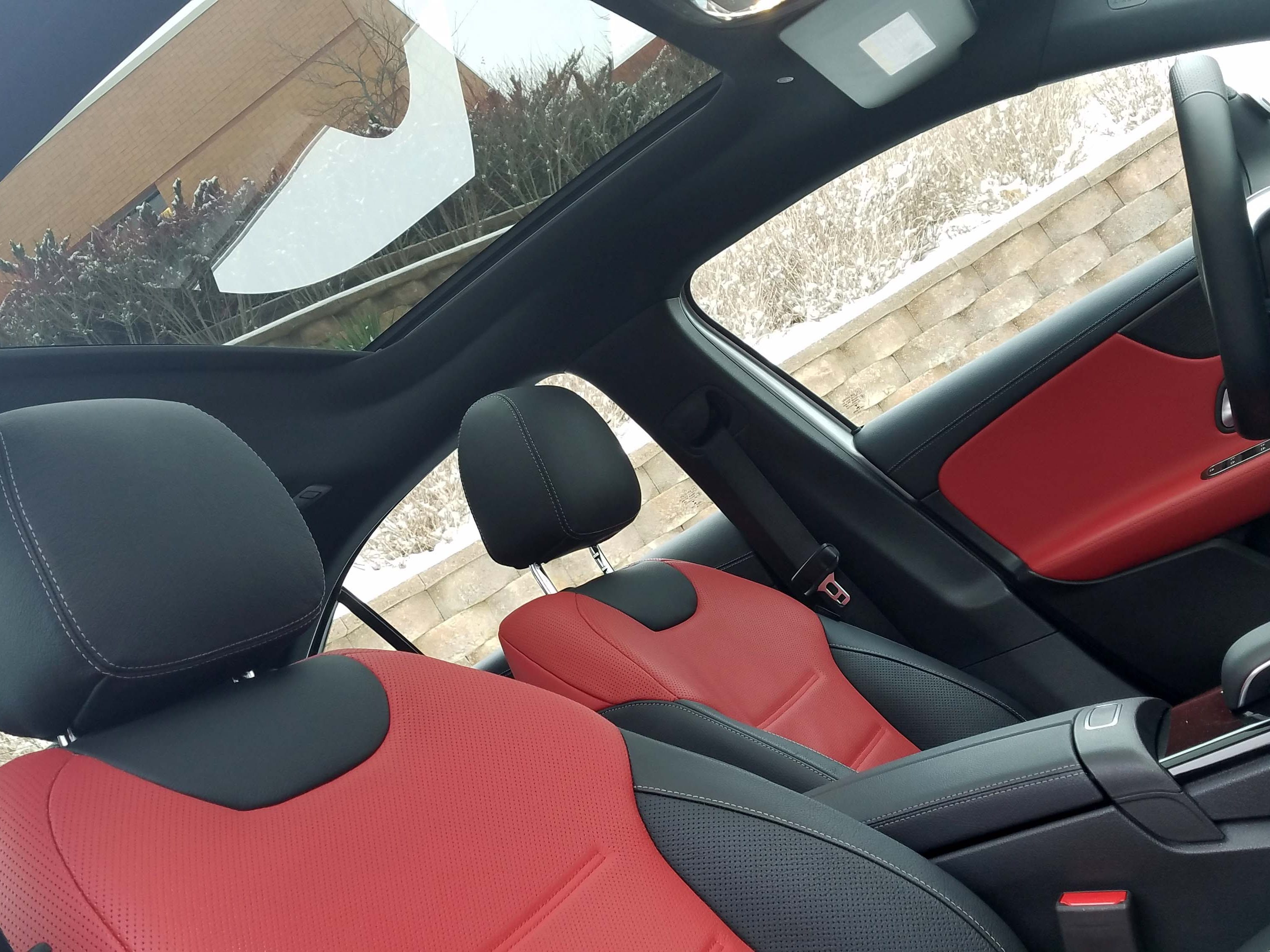 Options on the Mercedes A220 include a panoramic sunroof and red leather seats.
