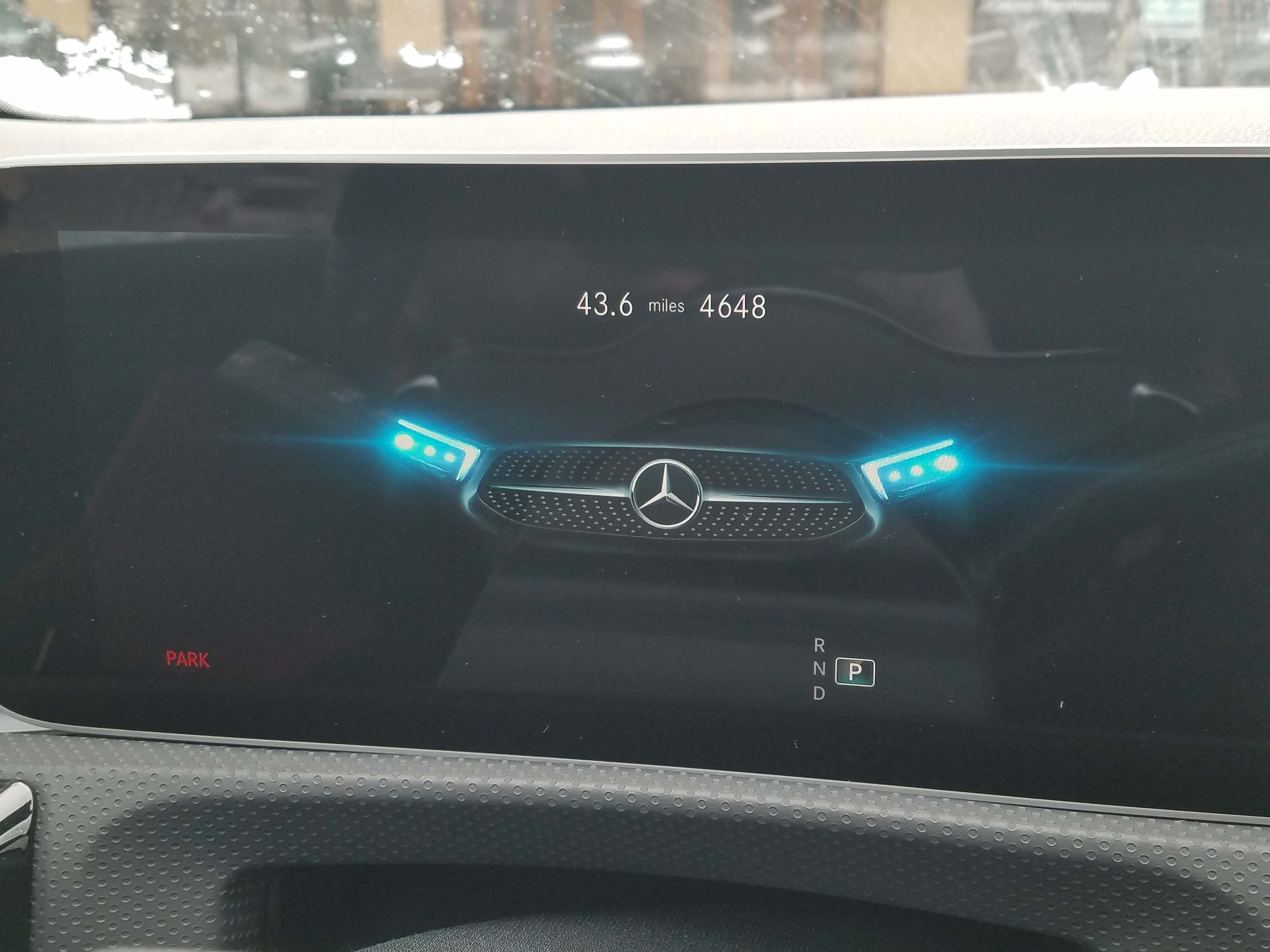 Owning a Mercedes A220 means cool touches like a Merc facial graphic that welcomes you into the car.