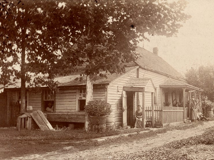 An 1892 photo shows the James Smith log house, built sometime after the land was purchased 1829, in what was then called Greenfield Township.