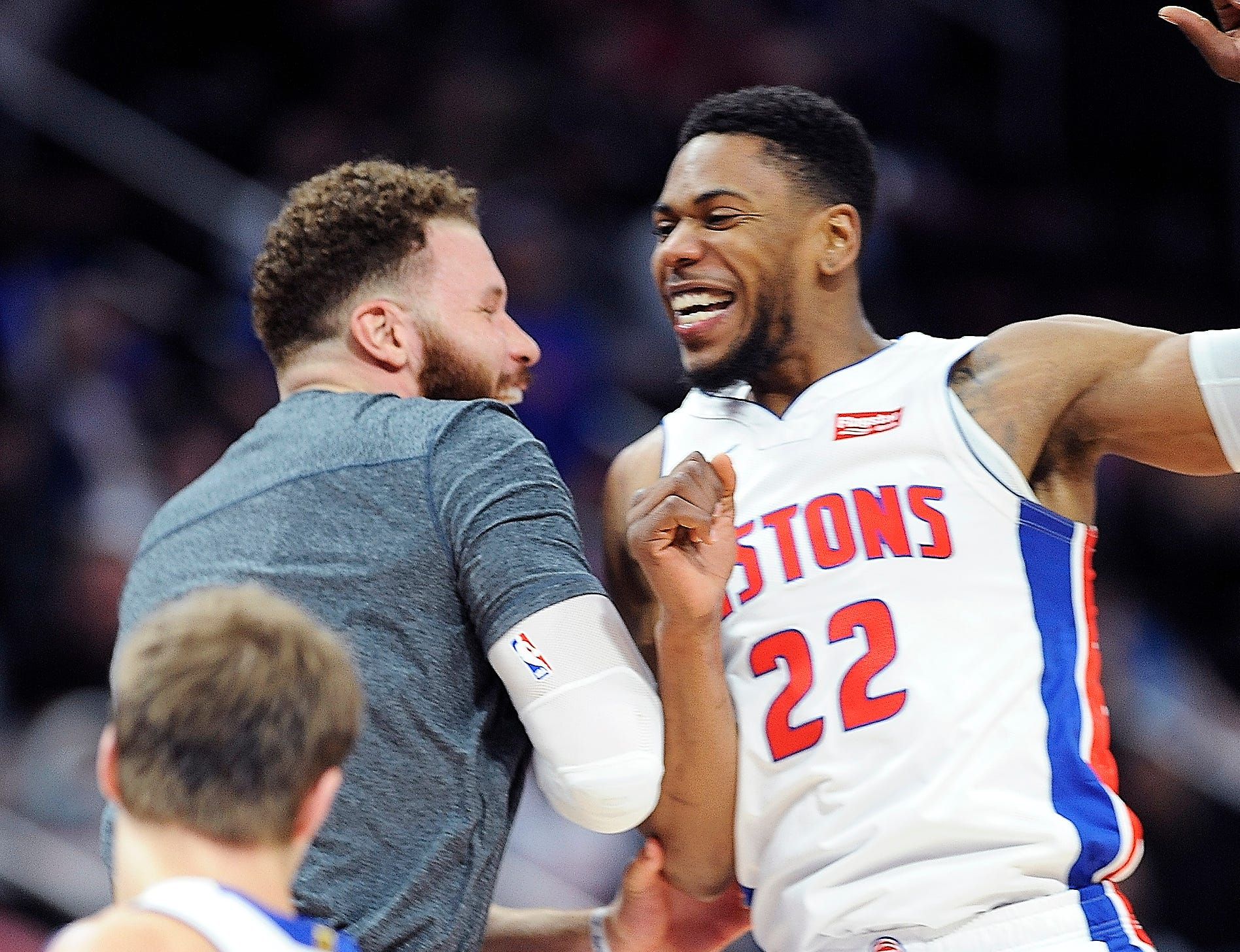 Pistons' Glenn Robinson III celebrate with Blake Griffin after a basket in the fourth quarter.