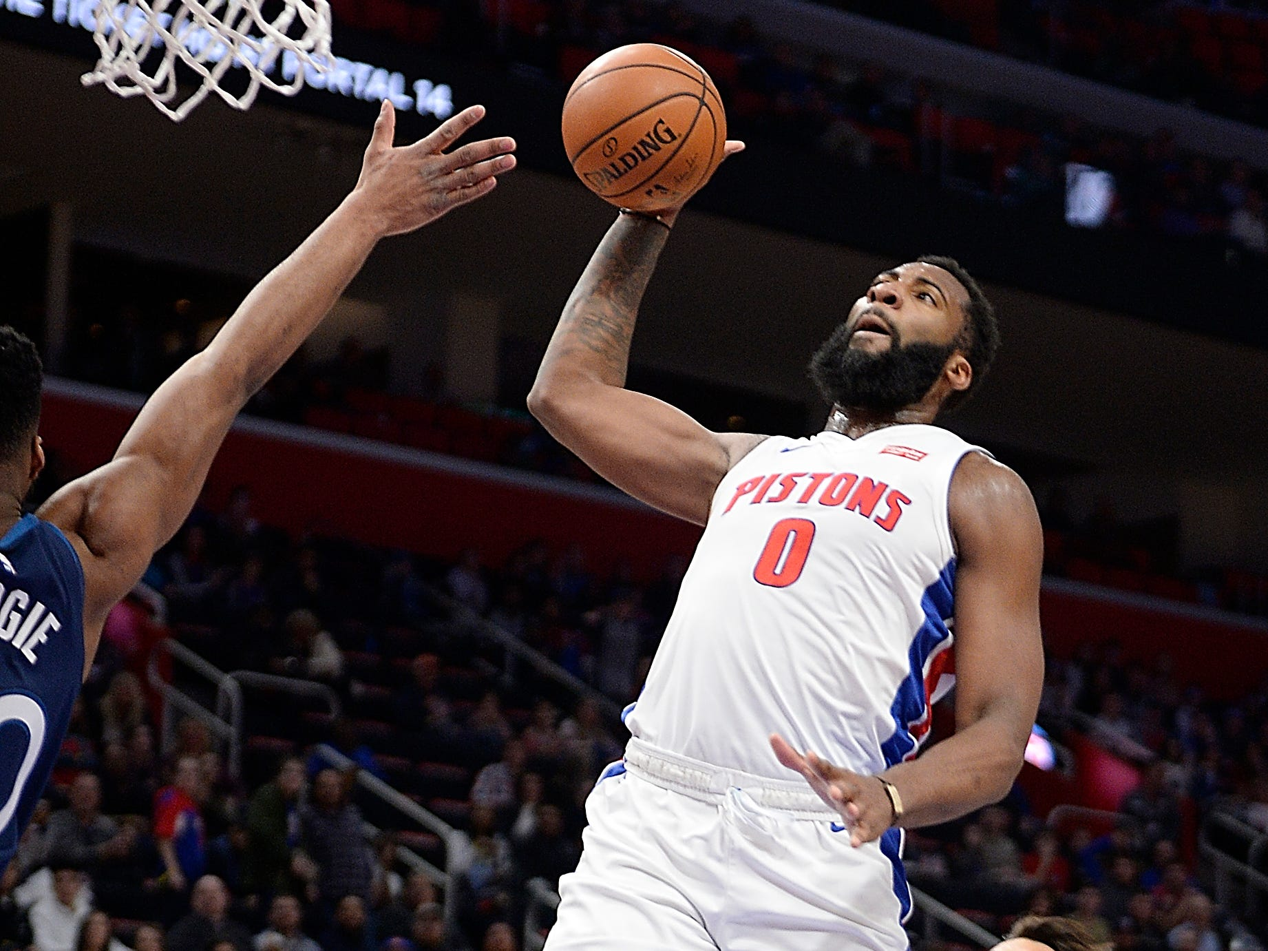 Pistons' Andre Drummond dunks over Timberwolves' l-r, Josh Okogie and Dario Saric in the second quarter. Drummond had 31 points and 15 rebounds.
