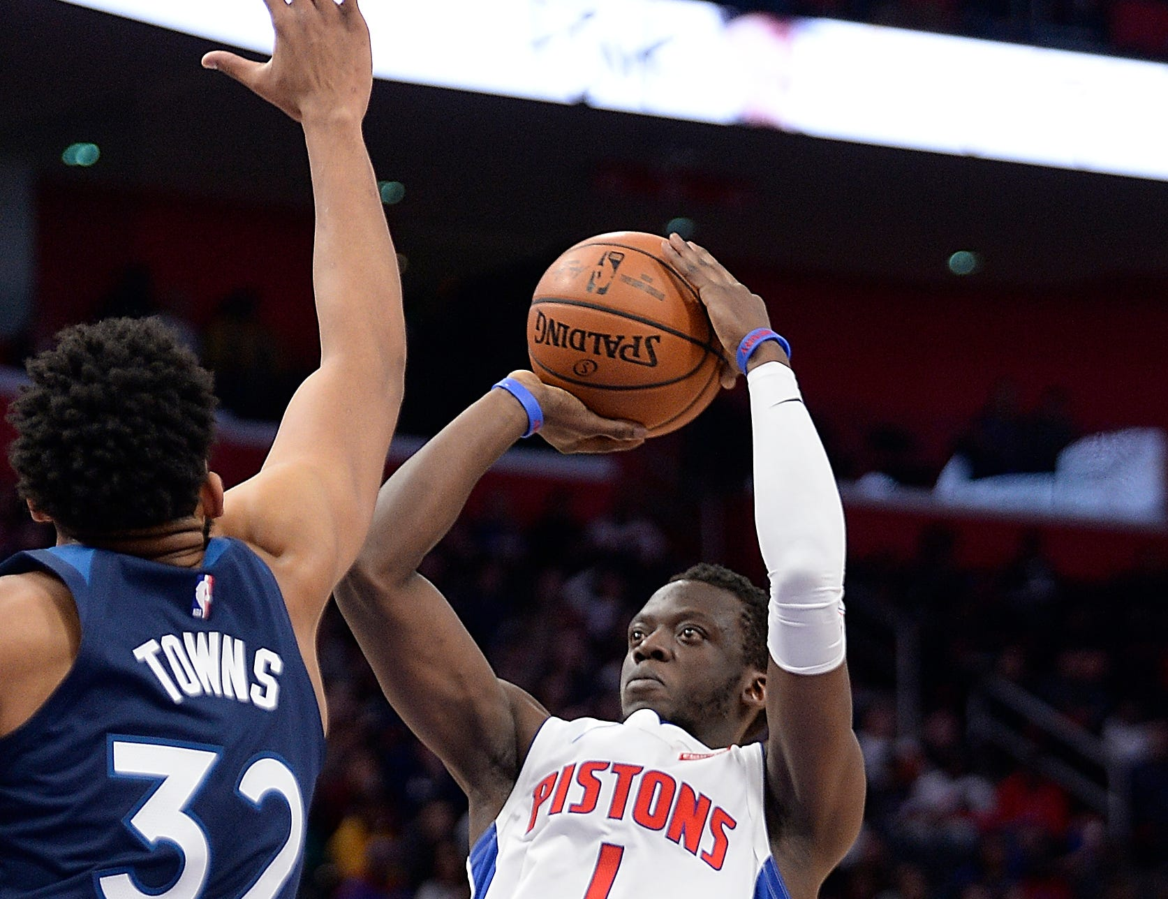 Pistons' Reggie Jackson shoots over Timberwolves' Karl-Anthony Towns in the second quarter.