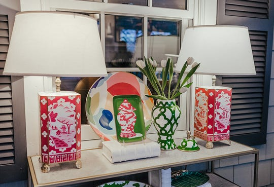 Two lamps are sometimes better than one. These bright pink lamps act as bookends for the table and compliment the green and white accents. (Handout/TNS)