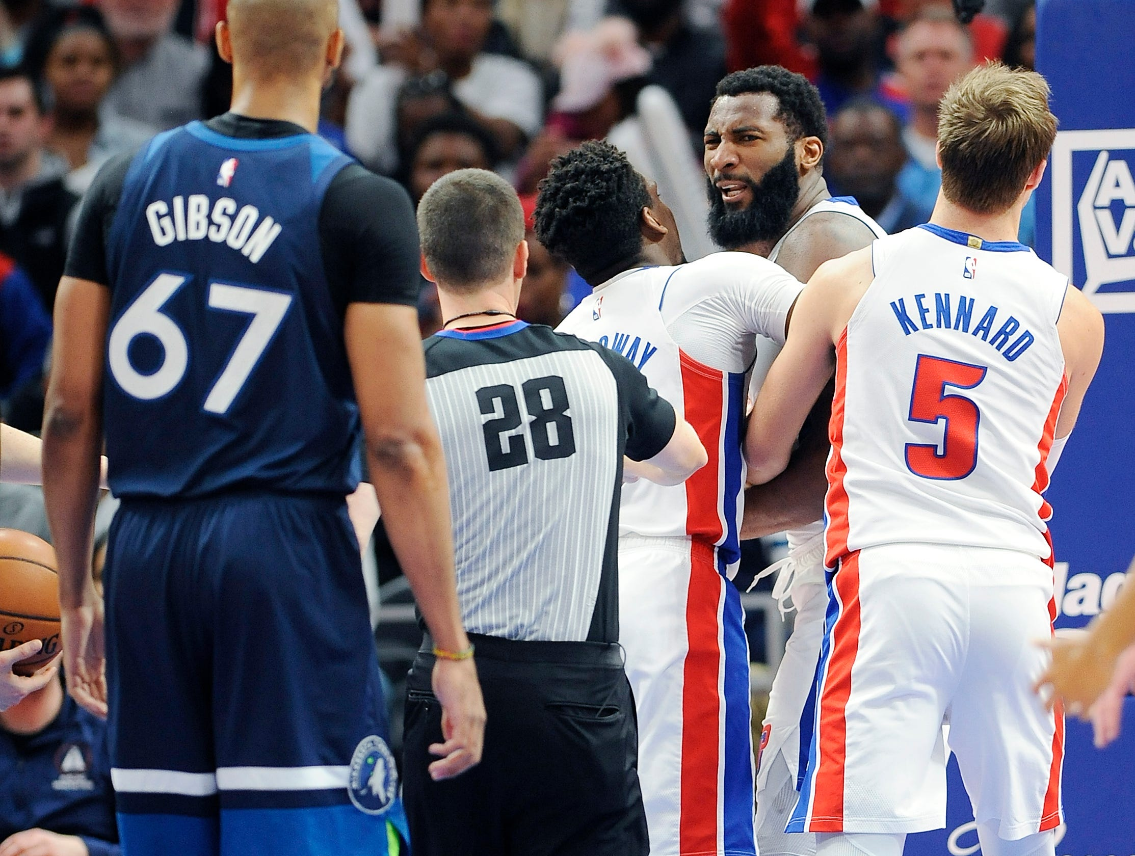 Pistons' Langston Galloway and Luke Kennard hold Andre Drummond back after he was hit in neck by Timberwolves' Taj Gibson in the fourth quarter.