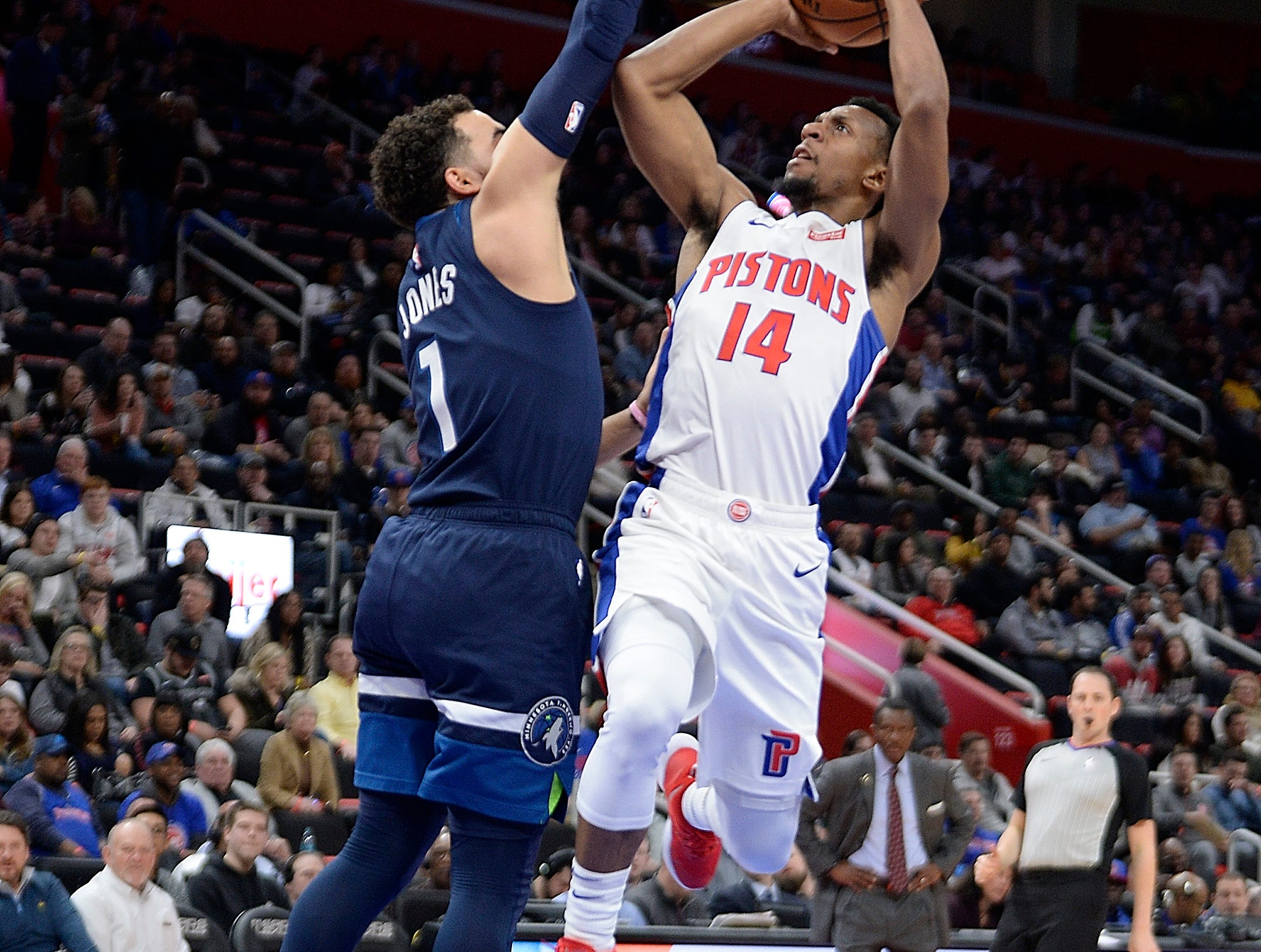 Pistons' Ish Smith shoots over Timberwolves' Tyus Jones in the secopnd quarter. Smith was fouled on the play at Little Caesars Arena.