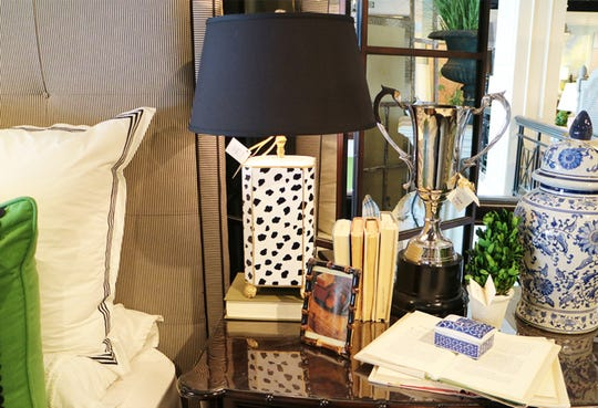 Patterned lamps bring a fun and powerful energy to any space. Utilizing a lamp with a black shade is a nice venture from the classic white and really stands out. (Handout/TNS)