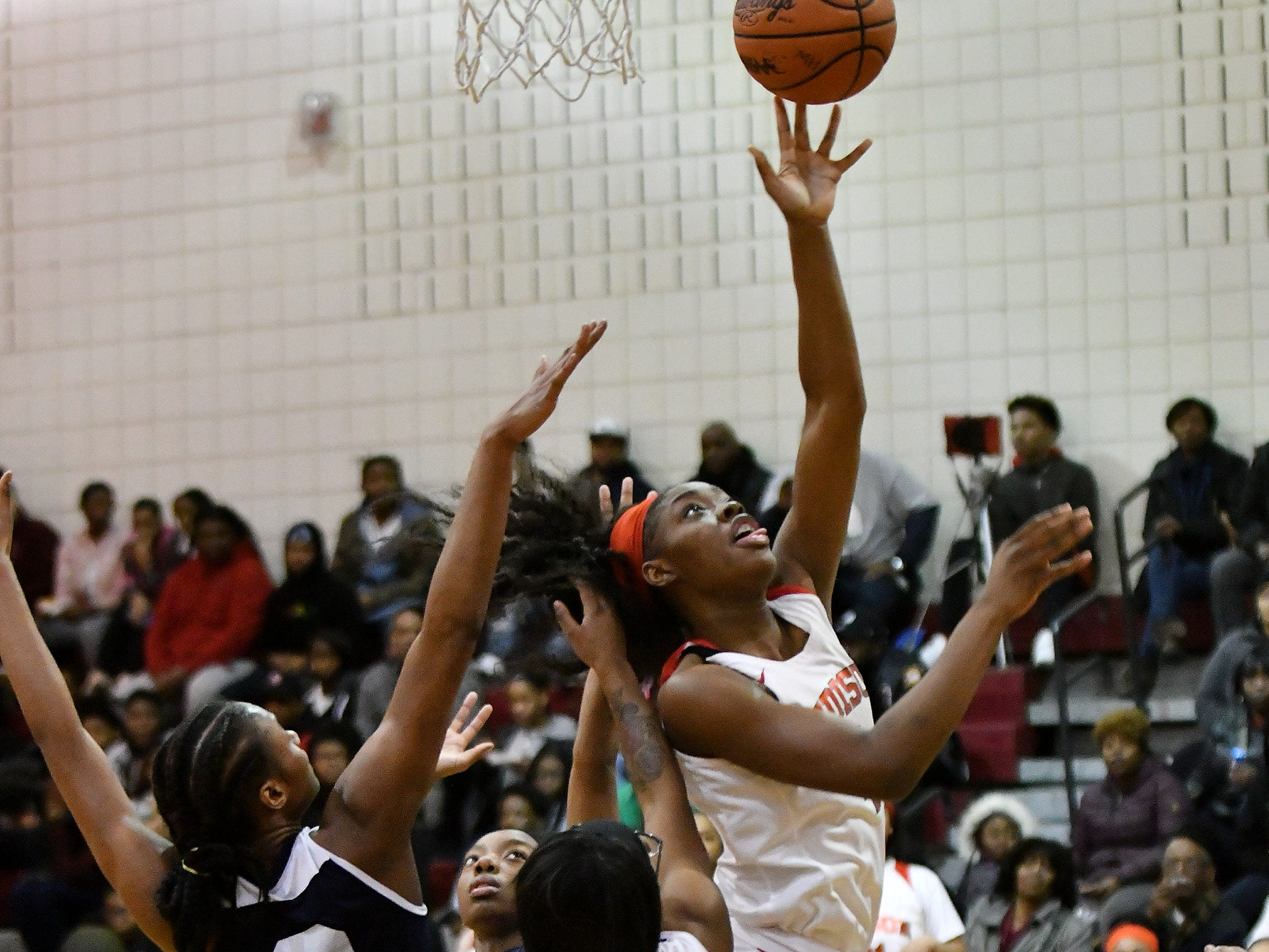 Detroit Edison's Ariel Jenkins puts up a shot amidst Chandler Park's Tiana Mason (2) and Anaya Kennedy (5) in the second half.