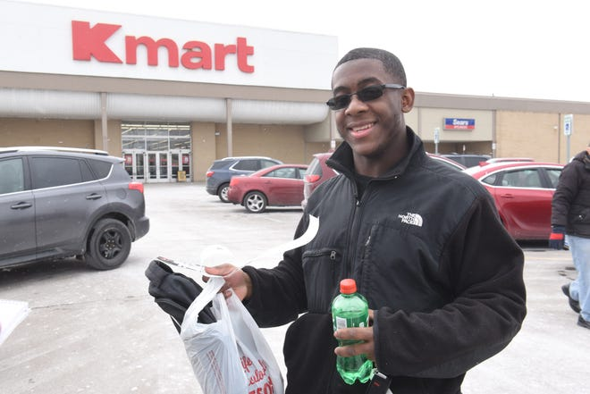 """Dalante Tyler lives around the corner from the Warren Kmart.  """"They have really good customer service,"""" he said. """"The cashiers are kind, and they have better prices than other stores."""""""