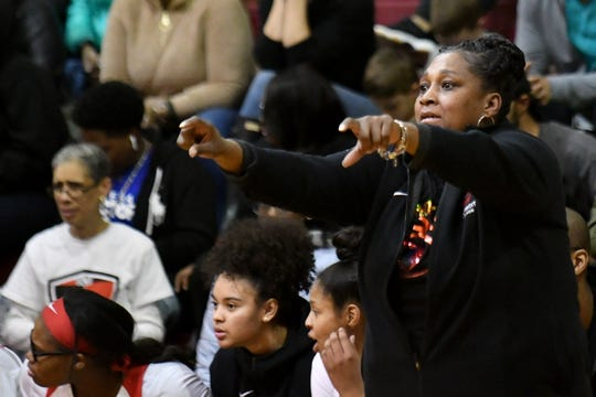 """Detroit Edison head coach Monique Brown benched two players to start the game for disciplinary reasons: """"The two (players) that stepped in (to the starting lineup) were probably very nervous. Once we got going, I told them it was just basketball. After we settled down I think we were OK."""""""
