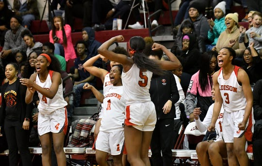 Detroit Edison starters, now on the bench in the fourth quarter, celebrate a basket in the 79-49 win over Chandler Park Academy in the District 59 game at Harper Woods High School in Detroit on Mar. 6, 2019.  From left, Ariel Jenkins (4), Daija Tyson (1), Rickea Jackson (5) and Gabrielle Elliot (3) .