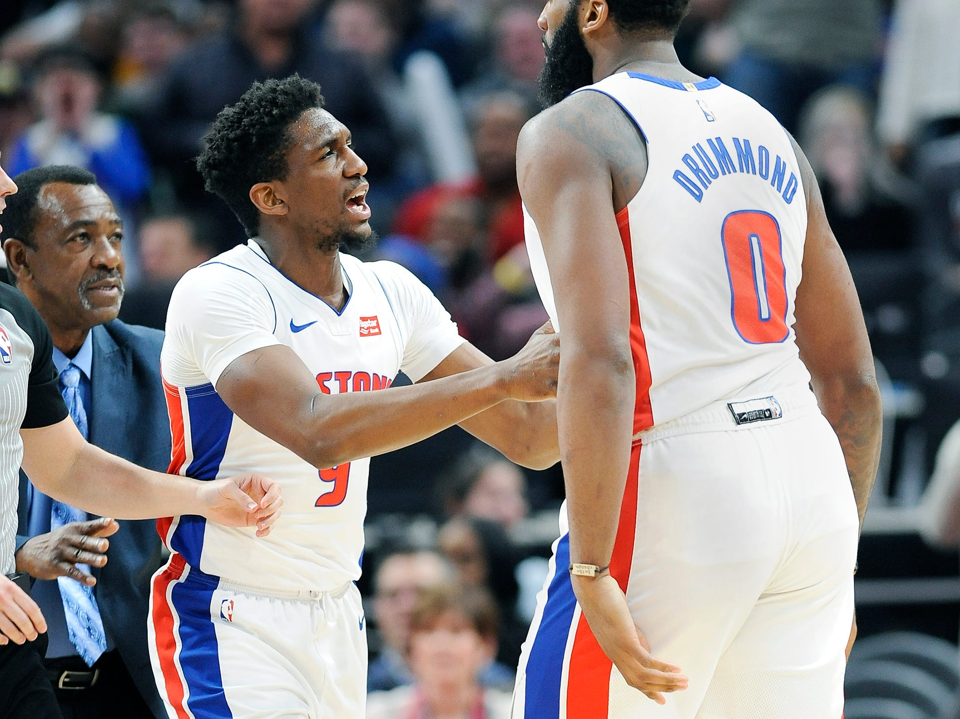Pistons' Langston Galloway holds Andre Drummond back after he was hit in neck by Timberwolves' Taj Gibson in the fourth quarter.,Gibson received a flagrant 2 foul and was ejected.
