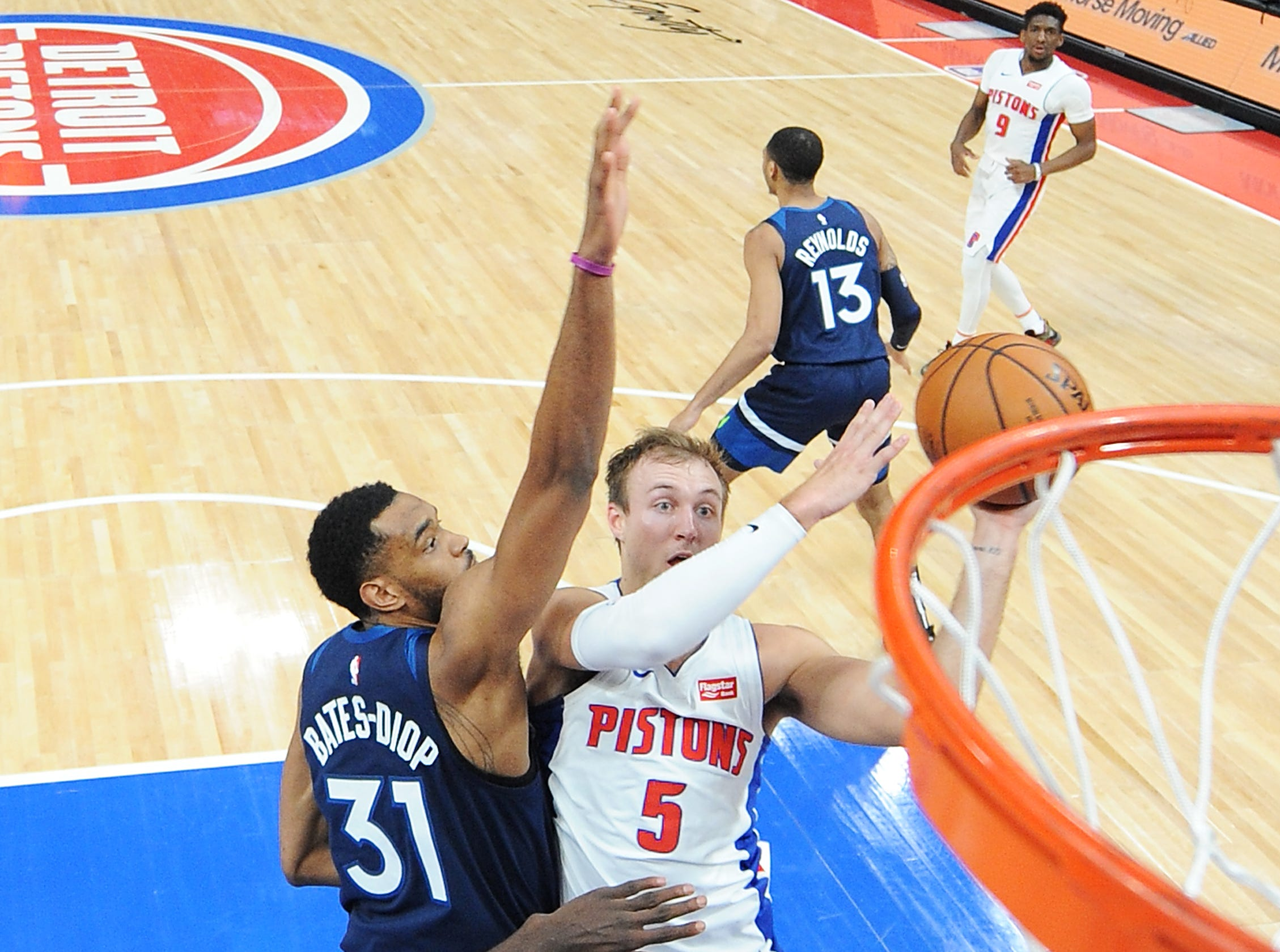 Pistons' Luke Kennard scores over Timberwolves' Keita Bates-Diop in the fourth quarter.