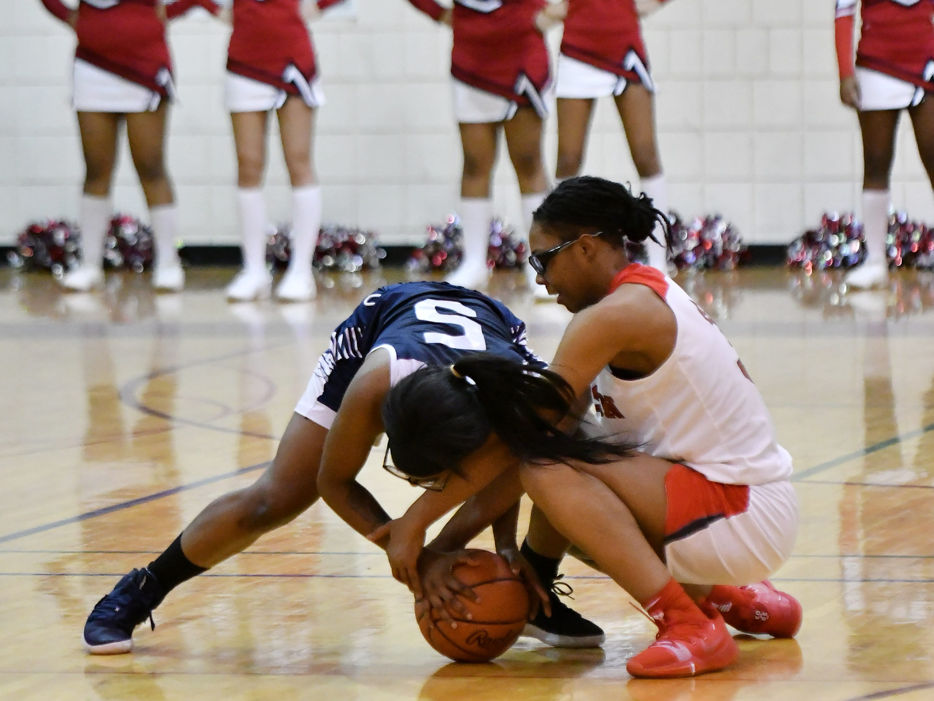 Chandler Park's Anaya Kennedy (5) and Detroit Edison's Gabrielle Elliot battle for the ball in the first half.