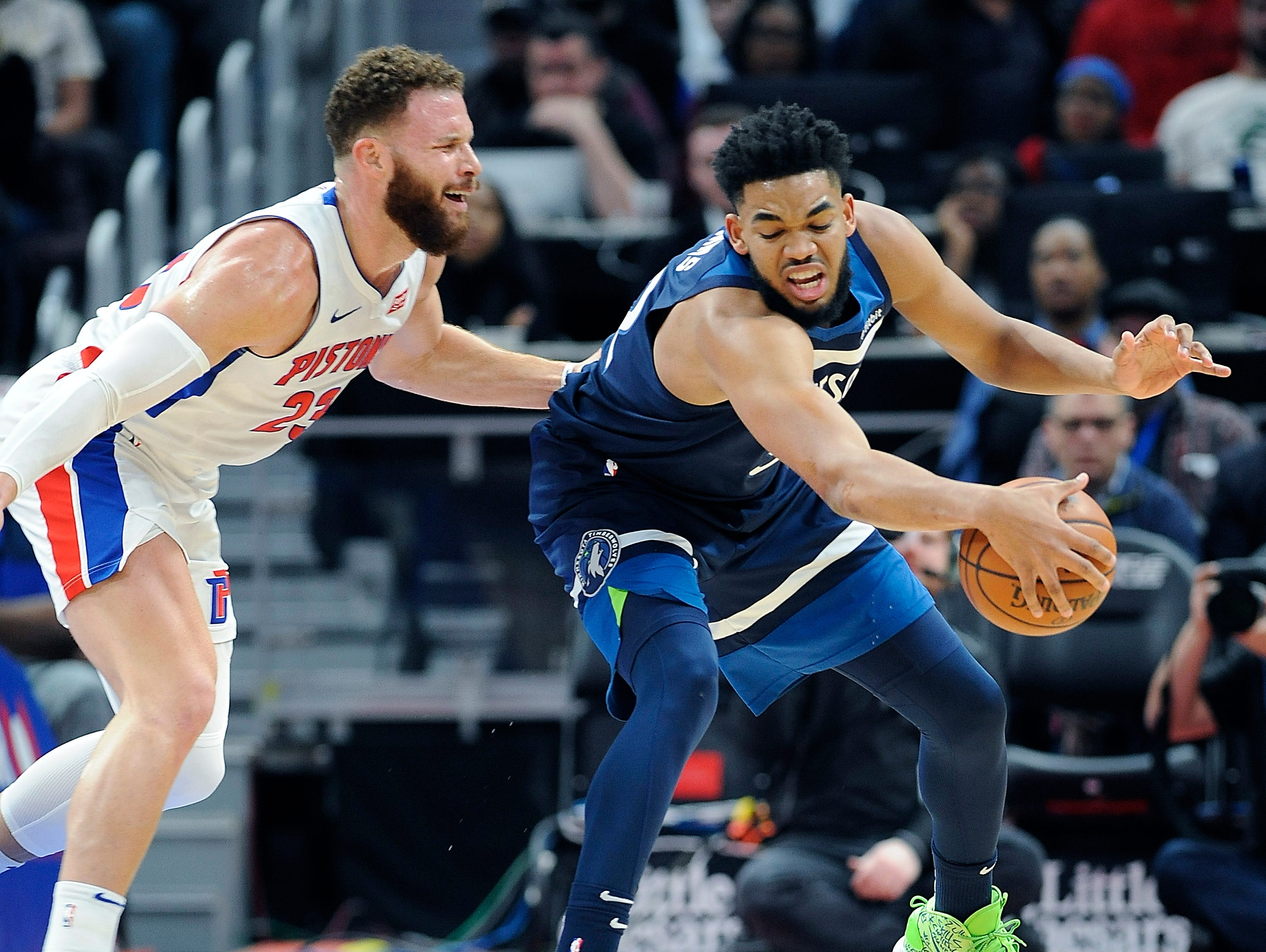 Pistons' Blake Griffin defends the Timberwolves' Karl-Anthony Towns in the first quarter.