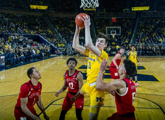 Michigan forward Colin Castleton goes to the basket during the win over Nebraska on Feb. 28.