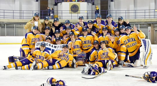 Elmira College's women's hockey team poses with its trophy after winning the 2019 UCHC Tournament title May 3, 2019 at the Murray Athletic Center.