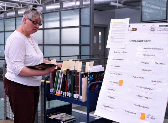Brenda Hill, a volunteer docent at the Corning Museum of Glass, goes over incomplete and missing Wikipedia articles relating to women and glass at the first Corning Art+Feminism Edit-a-thon last year.
