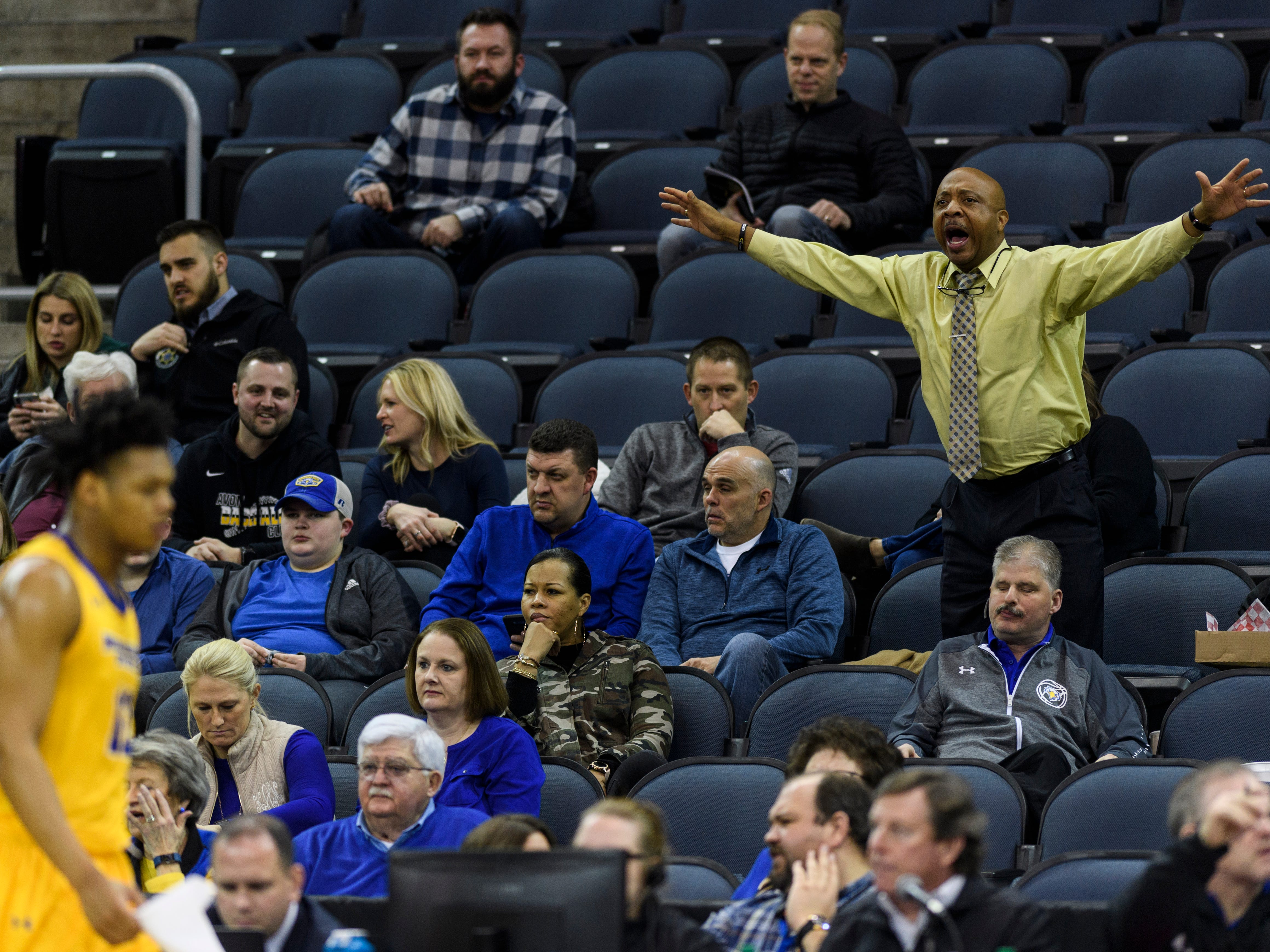 Dennis Henson, top right, reacts to the Morehead State Eagles versus Southern Illinois University Edwardsville Cougars game during the Ohio Valley Conference Tournament at Ford Center in Evansville, Ind., Wednesday, March 6, 2019. The Eagles, Henson's team, defeated the Cougars, 72-68.