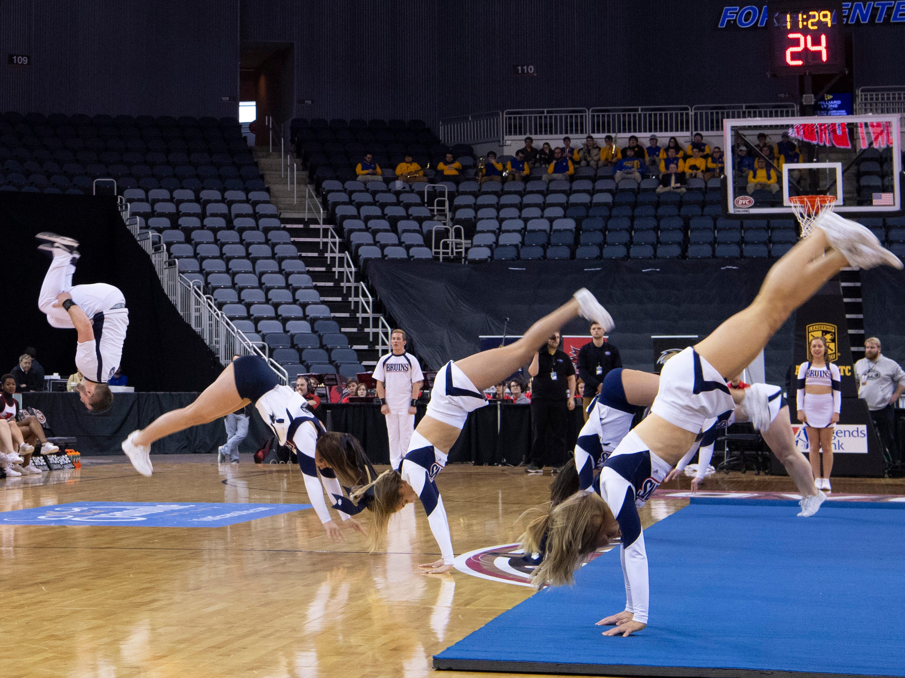 The Belmont University cheer squad performs at halftime of the women's game against Southeast Missouri at the Ohio Valley Conference Basketball Championships at the Ford Center Wednesday afternoon.