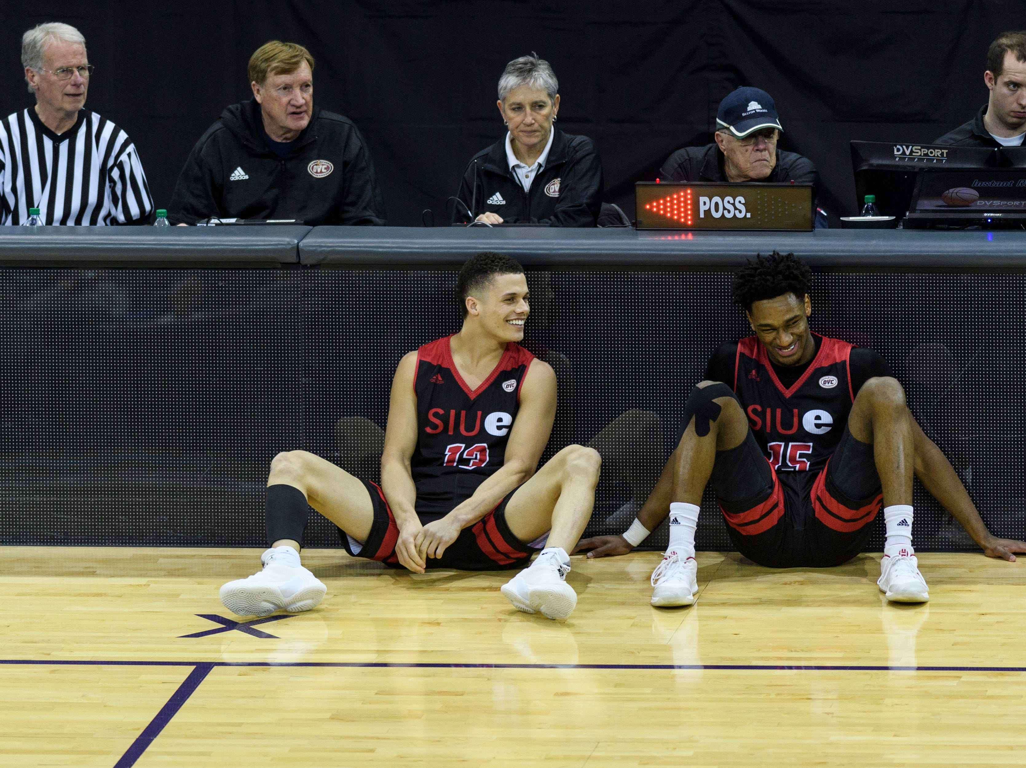 Southern Illinois University Edwardsville's Christian Ellis (13) David McFarland (15) laugh together as they wait to be subbed into the Ohio Valley Conference Tournament match-up against Morehead State at Ford Center in Evansville, Ind., Wednesday, March 6, 2019. Their team fell 72-68 to Morehead.