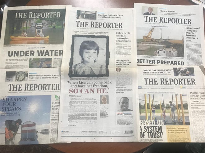 Pictured are a collection of 2017 and 2018 editions of The Reporter, bearing award-winning stories.