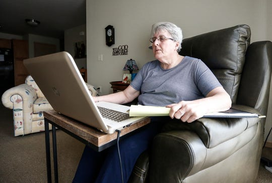"Nancy Candlish looks over requests for donations on her computer Thursday, March 7, 2019 at her home in Fond du Lac. Nancy is a volunteer for Care INC, which stands for ""Care in the Name of Christ."""