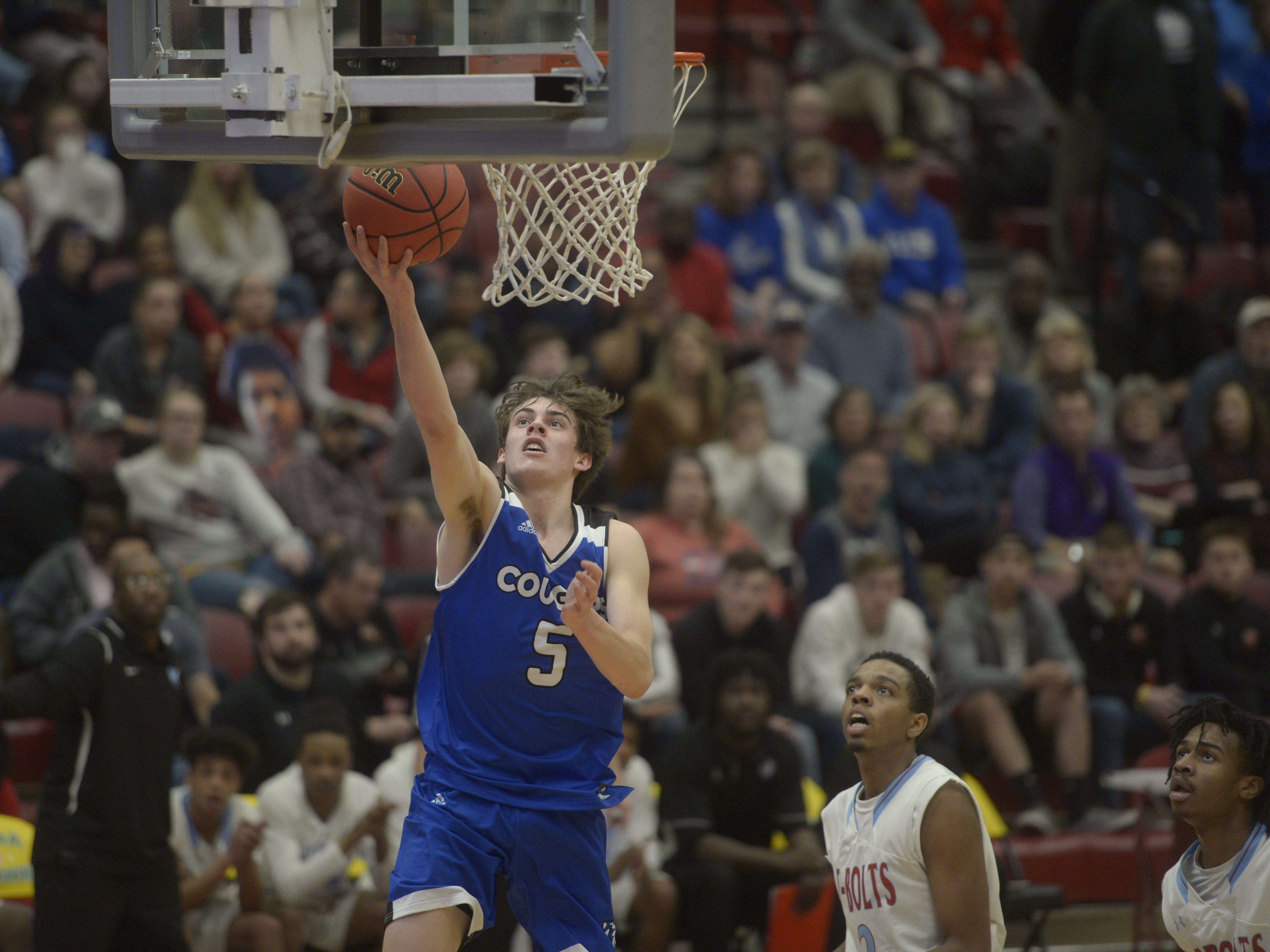 Resurrection Christian's Reece Johnson goes for a layup during the Cougars' 84-68 loss to Manual in the Class 3A quarterfinals on Thursday at the University of Denver.