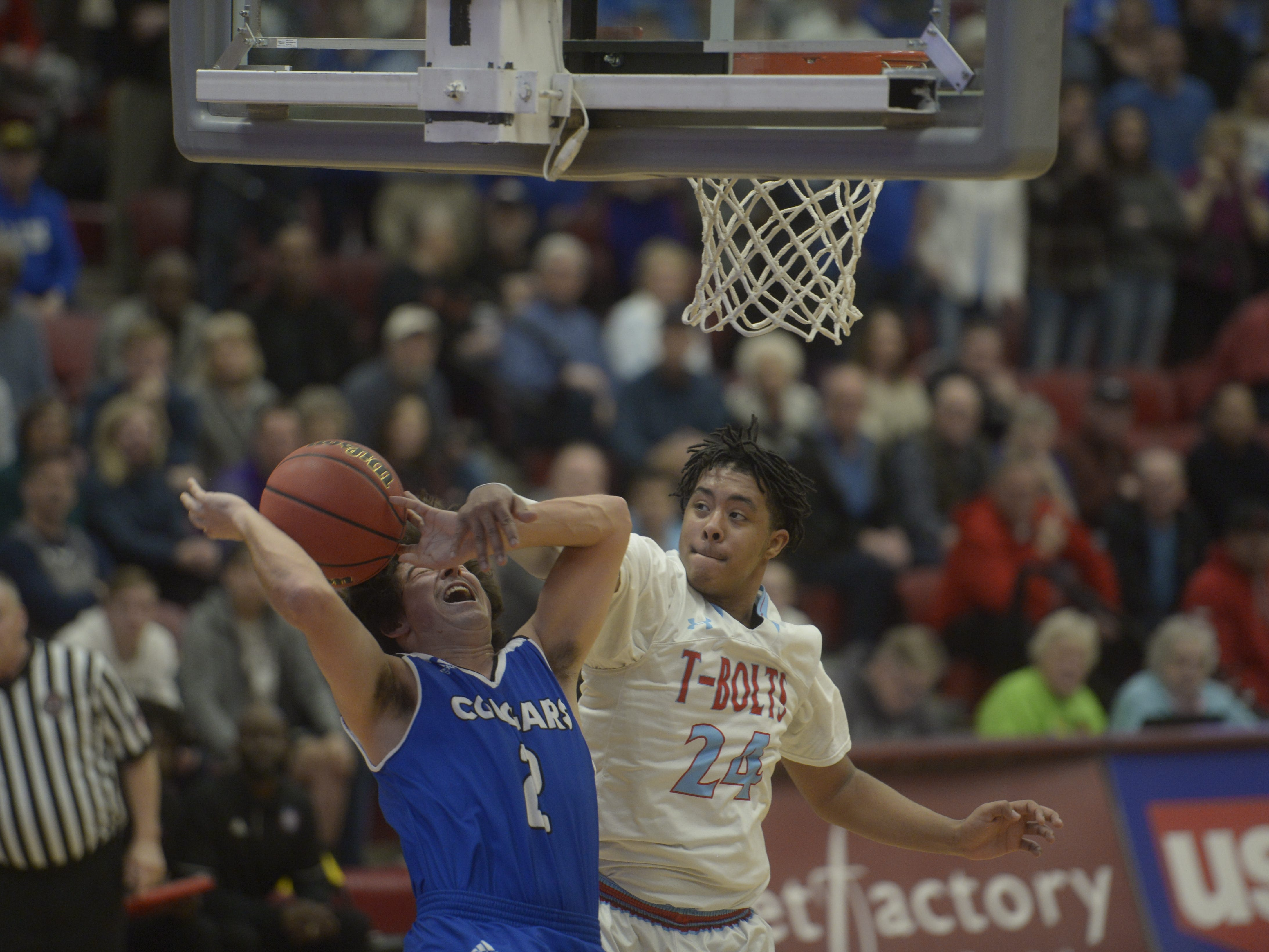 Resurrection Christian's Jackson Romero is fouled by Manual's Mekhi McGee during the Cougars' 84-68 loss to Manual in the Class 3A quarterfinals on Thursday at the University of Denver.