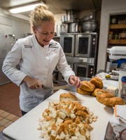 Donahue cubes croissants for her Key lime white chocolate bread pudding at Sweet Melissa's Cafe.