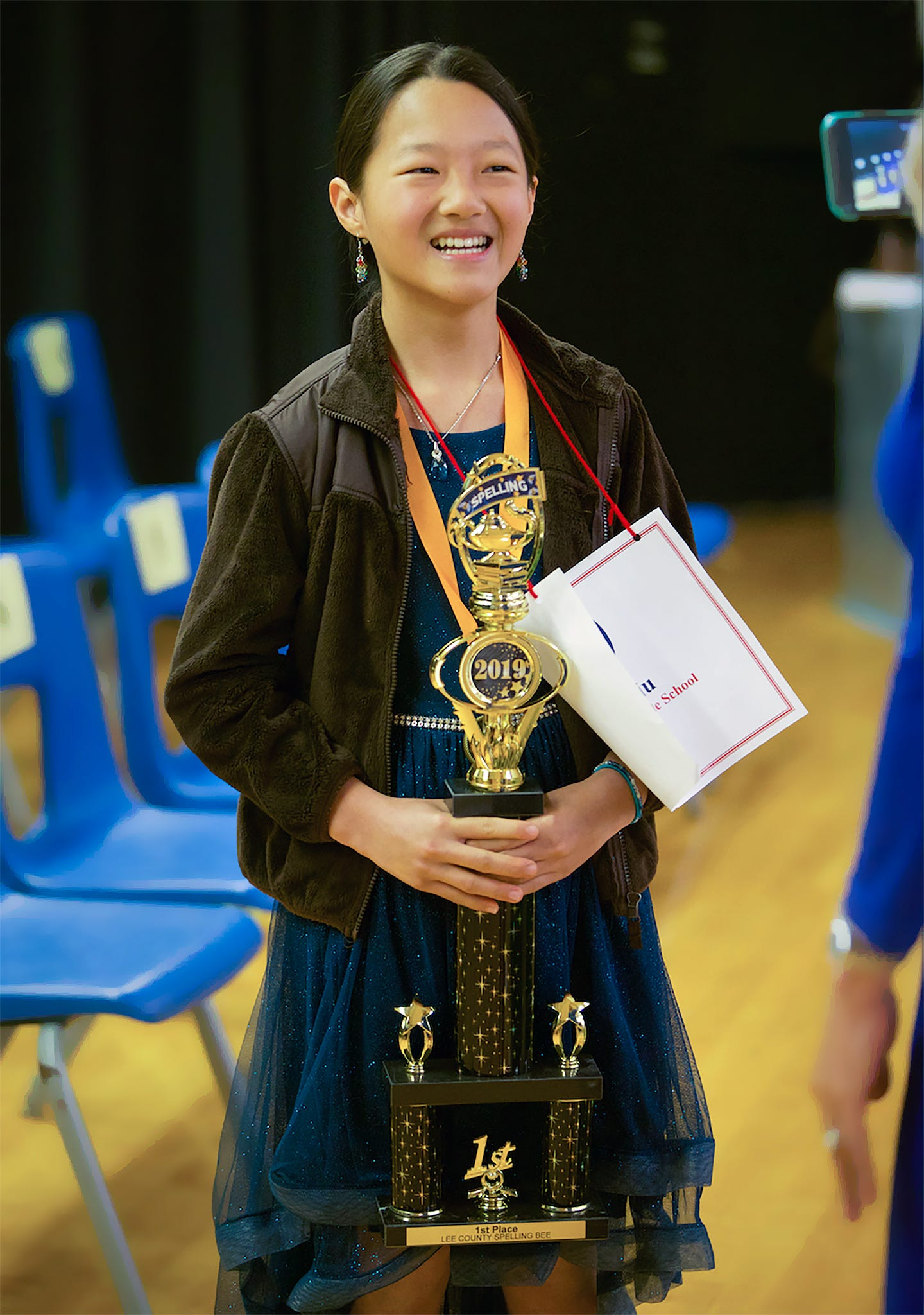 Isabel Liu celebrates winning the Lee County Spelling Bee on Wednesday at Three Oaks Middle School in Fort Myers. Isabel attends Cypress Lake Middle School and advances to the National Spelling Bee in Washington D.C in May.