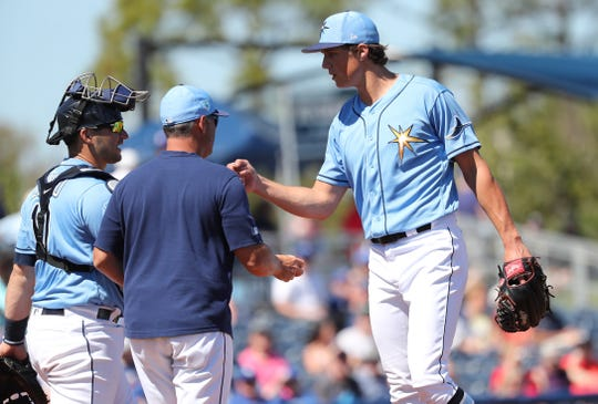 Tampa Bay Rays starting pitcher Tyler Glasnow is taken out of a game by manager Kevin Cash as catcher Mike Zunino looks on during the third inning at Charlotte Sports Park on March 7.