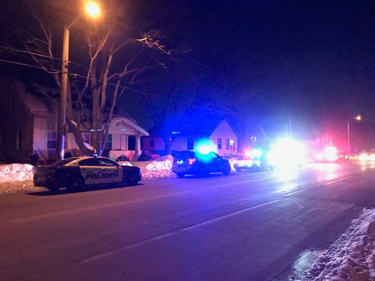 Police squad cars respond to a call in the area of East Walnut Street and Irwin Avenue.