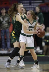Freedom's Taylor Haase (22) defends against Laconia's Lexy Smit (12) during their Division 3 semifinal game at the WIAA girls state basketball tournament Thursday, March 7, 2019, at the Resch Center in Ashwaubenon.