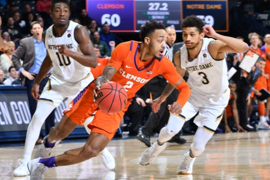 Clemson guard Marcquise Reed (2) dribbles the ball as Notre Dame guard Prentiss Hubb (3) defends at the Purcell Pavilion Wednesday night in South Bend, Ind.