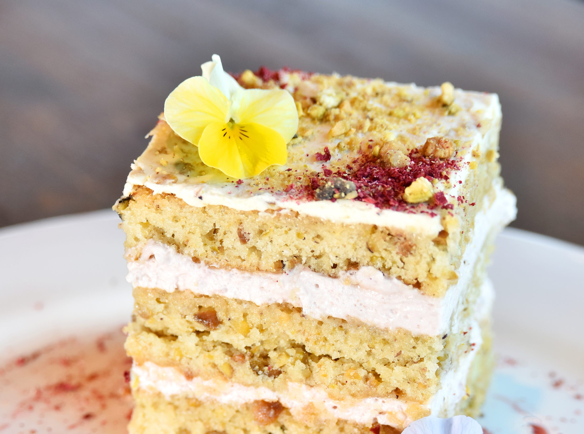Toasted pistachio and strawberry cake with strawberry coulis and stawberry dust made by Samantha Fredrickson at Stella's Southern Brasserie.